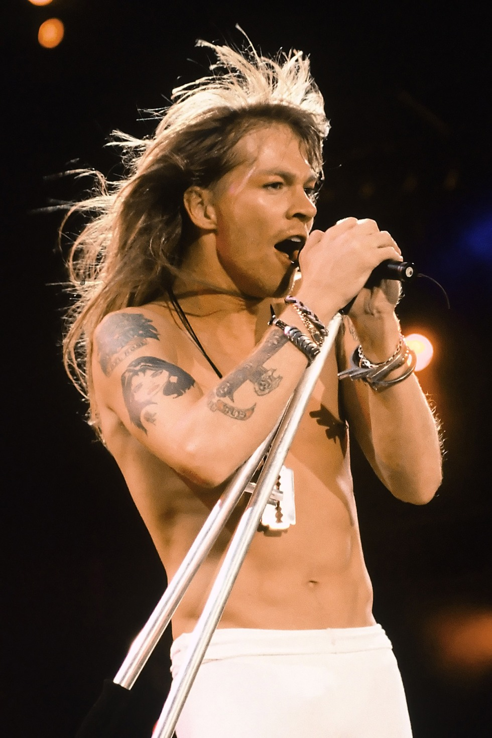 Axl Rose of Guns N' Roses, in their second performance at the Rock in Rio II Festival Guns N' Roses - Rock in Rio II Rio Rio de Janeiro,  Brazil January 15, 1991 Photo by George Chin/WireImage.com  To license this image (7719358), contact WireImage: U.S. +1-212-686-8900 / U.K. +44-207 659 2815 / Australia +61-2-8262-9222 / Japan: +81-3-5464-7020 +1 212-686-8901 (fax) info@wireimage.com (e-mail) www.wireimage.com (web site)
